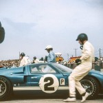 1966 Sebring, 12 hours of Endurance – Dan Gurney arrives at the door of his Ford MK 2 he shared with Grant. On the last lap the car's engine failed. Dan was pushing his car on the course, and he made it to the finish line and came in 2nd. Although pushing a car was illegal - and the car was disqualified; photographed by Suzie Dietrich, USA