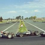 1966 Gran Premio de México, Autódromo Hermanos Rodríguez – Jo Siffert followed by Graham Hill and Moisés Solana passing Horquilla, they did not finish the race; photographed by Pete Biro, USA