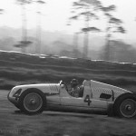 """1938 Donington, IV Donington Grand Prix – The 46 year old Tazio Nuvolari on way to a well deserved victory in the Auto Union D-type. During practice the """"Mantovano volante"""" collided with a stag."""