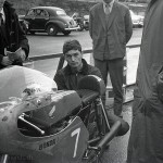 1962 Mallory Park, International Road Races – World champion Jim Redman with his Honda 250cc in the pits; photographed by John Robinson, UK