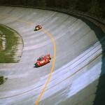 1967 Monza, 1000 km – Unforgettable Jonathan Williams in the Ferrari Dino 206S passes the sopraelevata followed by Teddy Pilette in the Alfa Romeo TZ2