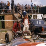 1966 Silverstone, XVIII BRDC International Trophy - Heini Mader and Jo Bonnier (finished 3rd) with the AngloSwiss Cooper-Maserati T81 V12 in the paddock; photographed by David Baxter, F